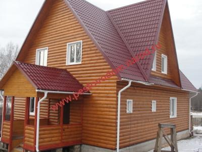 Дом с кровлей металлочерпица